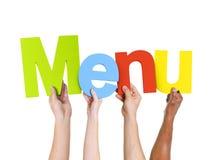 Personnes multi-ethniques tenant le menu de Word Image stock