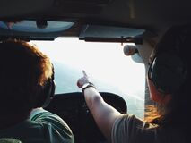 Persons on Aircraft Pointing on View during Daytime Stock Photos
