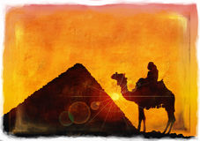 Persons on camel beside pyramids Stock Images