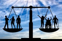 Concept of social equality of disabled people in society. Persons with disabilities have equal rights in the balance with healthy people. Concept of social stock photography