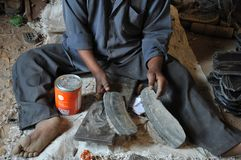 Persons with disabilities have organized a workshop for manufacturing of footwear of the tire Hargeisa Royalty Free Stock Photo