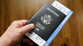 Persons hand holding a passport of United States Royalty Free Stock Photo
