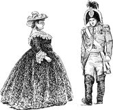 Persons in the  historical costumes Stock Photography