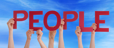 Persons Holding People in the Sky. Many Persons Holding the Red Word People in the Sky Royalty Free Stock Image