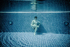 Persons lies under water in a swimming pool Stock Images