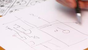 Persons plan för handteckning på blått tryck Närbild stock video