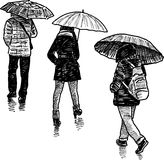 Persons in the rain Royalty Free Stock Image
