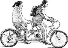 Persons ride a tandem Stock Images