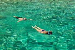 Persons snorkeling near keri blue caves bay  in Zakynthos Zante. Island, in Greece Royalty Free Stock Photo