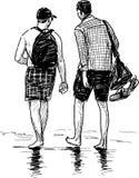 Persons walking at seashore Royalty Free Stock Photography
