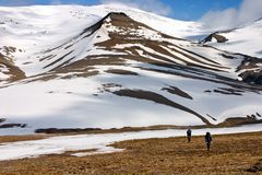 Persons Walking Tundra in Svalbard Royalty Free Stock Images