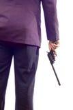 Persoon in een kostuum dat een kanon houdt Royalty-vrije Stock Afbeeldingen