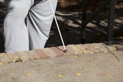 Persoon met Cane Walking Royalty-vrije Stock Afbeelding