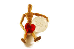 Persoon met een hart en een kristallen bol Royalty-vrije Stock Foto's
