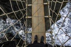 Persoon over brug Royalty-vrije Stock Afbeeldingen