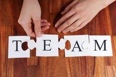 Persoons in verwarring brengend TEAM stock foto