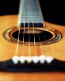 Perspectiva de la guitarra acústica Foto de archivo libre de regalías