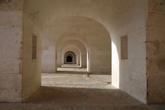 Perspective. Through a passage under the walls of the fortress Royalty Free Stock Photography