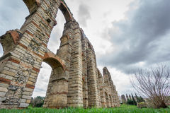 Perspective of aqueduct of the Miracles in Merida, Spain, UNESCO. Ultra wide perspective view of Aqueduct of the Miracles in Merida against stormy sky, Spain Royalty Free Stock Photos