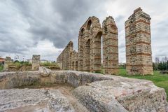 Perspective of aqueduct of the Miracles in Merida, Spain, UNESCO. Ultra wide perspective view of Aqueduct of the Miracles in Merida against stormy sky, Spain Stock Images