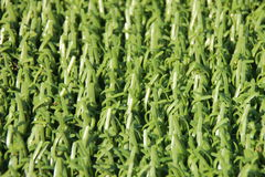 Perspective of artificial fake green plastic grass background Stock Photo