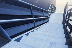 Perspective of blue industrial metal staircase Royalty Free Stock Image