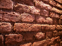 Perspective brick wall. Perspective view of a basement wall of bricks - colors accentuated artificially Royalty Free Stock Images