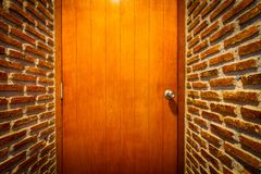 Perspective brick wall with the door Royalty Free Stock Photos