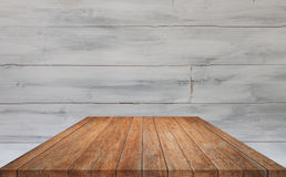 Perspective brown table top with white wooden wall background Royalty Free Stock Image