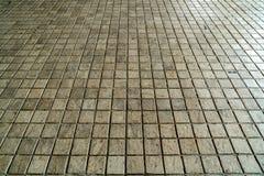 Perspective tiles floor. Perspective of brown tiles floor Stock Images
