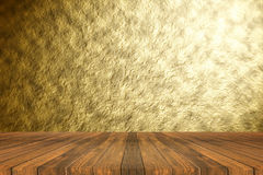 Perspective brown wooden floor against Abstract gold texture background with beautiful spotlight emit effect. Stock Photo