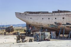 Perspective close shot of back side fishing boat on ground for painting of trunk at Lesvos, Kalloni. At summertime stock images