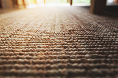 Perspective close-up beige carpet texture floor of living room. Background Royalty Free Stock Images