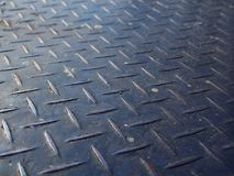 Perspective close up old rusty dirty blue iron steel checker plate Stock Image