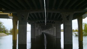 Perspective Construction From Under The Bridge. Water Around stock footage