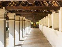 Perspective corridor to buddha in temple Stock Photos