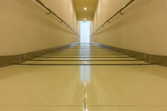 Perspective of corridor walkway and access way to elevator., Int Stock Photography