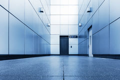 Perspective of corridor walkway and access way to elevator., Int Stock Images