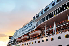 Perspective of Cruise ship during sunset. Royalty Free Stock Images