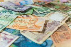 Perspective of different mixed international money bills royalty free stock image