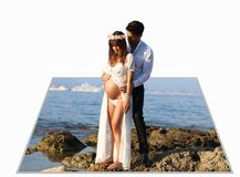 Perspective effect with 3D picture. Beautiful pregnant couple. Standing on the beach Royalty Free Stock Photography