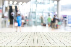 Perspective empty white wooden table over blurred shopping mall Royalty Free Stock Image