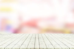 Perspective empty white wooden table over blurred shopping mall Stock Photos