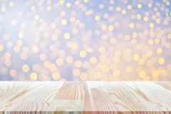 Perspective empty white wooden table on top over blur background. Can be used mock up for montage products display or design layout Royalty Free Stock Images