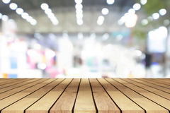 Perspective empty wooden table over blurred shopping mall backgr Royalty Free Stock Photography