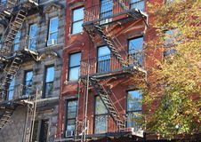 Perspective of Fire Escape Ladders on Apartment Building Block Royalty Free Stock Photography