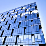 Perspective glass wall of skyscraper. In vivid colors Royalty Free Stock Photography
