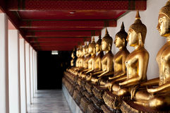 Perspective of gold buddha statue in temple Stock Image
