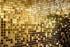 Perspective of gold square mosaic tiles for texture background. Perspective of gold yellow square mosaic tiles for texture background Royalty Free Stock Photography