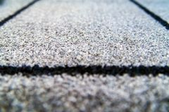 Perspective of grey carpet with black lines background texture, close up, gray textile texture, fluffy rug background. Selective. Perspective of grey carpet with stock image